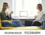 two female colleagues... | Shutterstock . vector #552386884