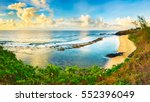 gris gris beach at sunrise.... | Shutterstock . vector #552396049