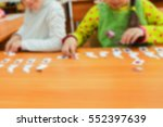Small photo of Young children engaged count in kindergarten. Materials for the study, counting to ten. Soft focus