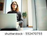 hipster girl use laptop huge... | Shutterstock . vector #552470755
