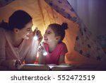 family bedtime. mom and child... | Shutterstock . vector #552472519