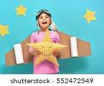 little child girl in an... | Shutterstock . vector #552472549