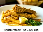 chicken fingers and chips | Shutterstock . vector #552521185