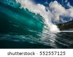 blue ocean wave crashing near... | Shutterstock . vector #552557125