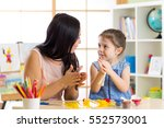 young mother and her child... | Shutterstock . vector #552573001