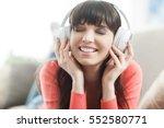 young smiling woman relaxing... | Shutterstock . vector #552580771