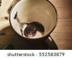 coffee grounds in a mug on the... | Shutterstock . vector #552583879
