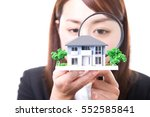 real estate agent inspecting a... | Shutterstock . vector #552585841