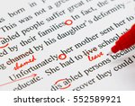 Stock photo closeup red marks on proofreading english document 552589921