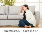 woman holding hurting tummy... | Shutterstock . vector #552611527