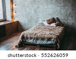 bed with a fur plaid and pillows | Shutterstock . vector #552626059