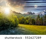 Day and night time composite image with spruce forest on a meadow  in Tatra mountains - stock photo