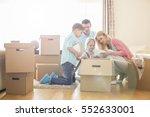 family unpacking cardboard... | Shutterstock . vector #552633001