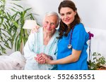 caring nurse supporting her... | Shutterstock . vector #552635551