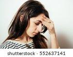 headache woman | Shutterstock . vector #552637141