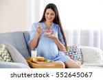 young pregnant woman with milk... | Shutterstock . vector #552645067