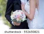 wedding couple with bouquet.... | Shutterstock . vector #552650821