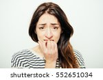 Stock photo woman bites his nails 552651034