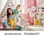 happy loving family. mother and ... | Shutterstock . vector #552686437