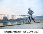 a handsome young man running in ... | Shutterstock . vector #552695257