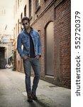 man wearing denim jacket and... | Shutterstock . vector #552720379