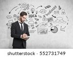 businessman with a notebook is... | Shutterstock . vector #552731749