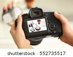 photo of makeup kit on camera... | Shutterstock . vector #552735517