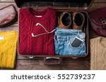open suitcase with casual... | Shutterstock . vector #552739237