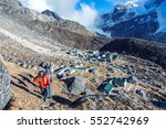 Small photo of View of Mountain Settlement in Nepal and group of Himalaya Climbers doing acclimatisation Training in for high Altitude Performance