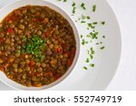 lentil soup decorated by parsley | Shutterstock . vector #552749719
