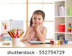 preschooler child girl drawing...   Shutterstock . vector #552754729
