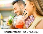 young cheerful friends toasting ... | Shutterstock . vector #552766357