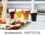 close up of four glasses of... | Shutterstock . vector #552771721