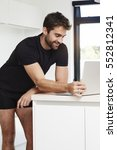 underwear dude on laptop in... | Shutterstock . vector #552812341