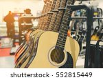 guitars  for sale hanging in a... | Shutterstock . vector #552815449