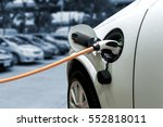 charging an electric car with... | Shutterstock . vector #552818011