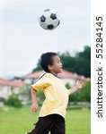 a local boy playing football | Shutterstock . vector #55284145