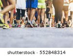 Stock photo marathon runners crowd people race outdoor sport training 552848314