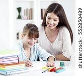 a mother helping her daughter... | Shutterstock . vector #552850489
