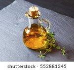 olive oil bottle with oregano... | Shutterstock . vector #552881245