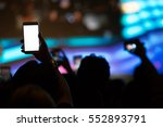 hand with a smartphone records... | Shutterstock . vector #552893791