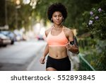 woman runner in action.... | Shutterstock . vector #552893845