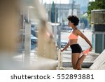 young fitness woman stretching... | Shutterstock . vector #552893881