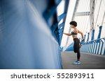 fitness girl taking a break... | Shutterstock . vector #552893911