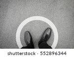 businessman standing in white...   Shutterstock . vector #552896344