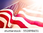 flag of the usa with sunflare | Shutterstock . vector #552898651