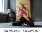 young slim blond woman in yoga... | Shutterstock . vector #552939145