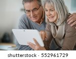 senior couple at home using... | Shutterstock . vector #552961729