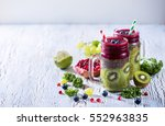 green and red smoothie with... | Shutterstock . vector #552963835