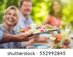 close up on hands holding a... | Shutterstock . vector #552992845
